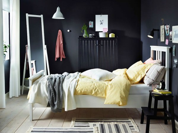 NYPONROS-bed-frame-stands-in-contrast-to-the-dark-backdrop-and-sideboard