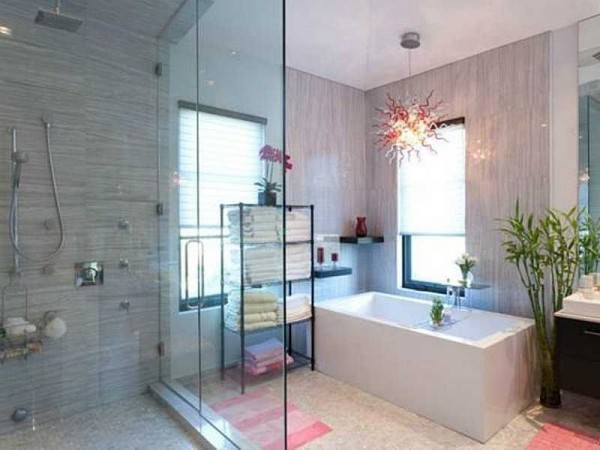 the-master-suite-has-a-balcony-that-overlooks-the-pool-and-a-bathroom-with-a-crazy-light-fixture-that-you-can-stare-at-while-you-soak-in-the-tub