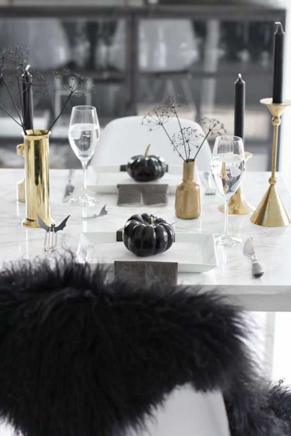 A-less-scary-Halloween-table-setting-in-black-and-gold