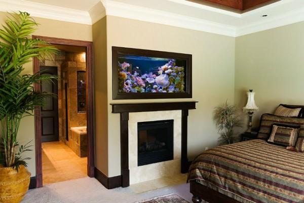 Aquarium-above-fireplace-in-bedroom