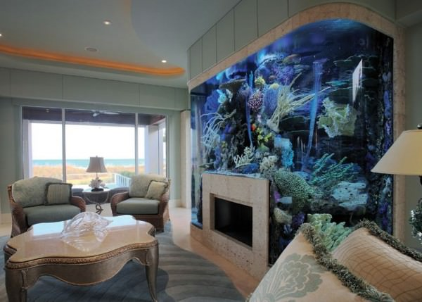 Aquarium-surrounding-fireplace-in-living-room