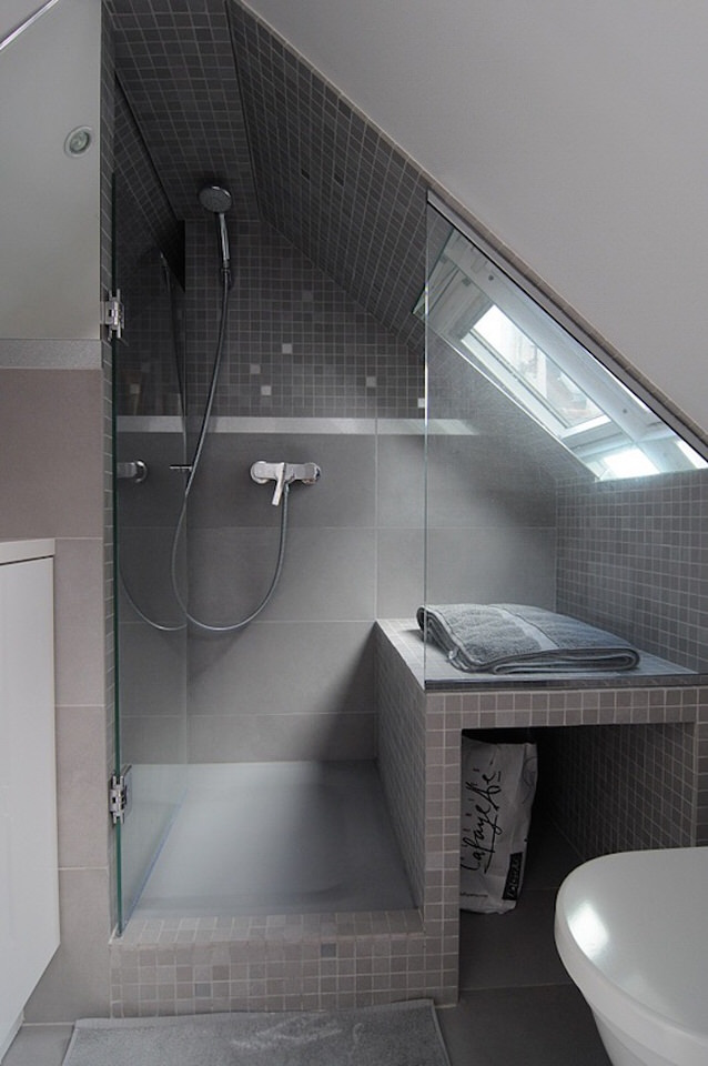 Beautiful-gray-tiled-shower-in-a-small-attic