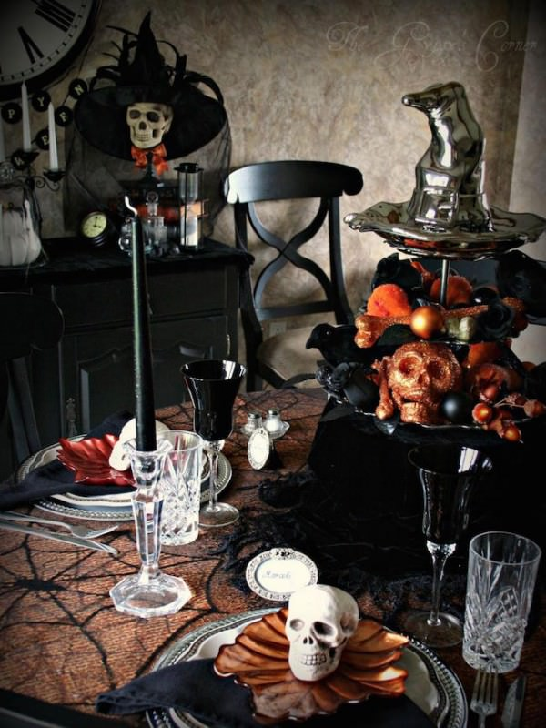Black-and-orange-Halloween-table-setting-with-lots-of-skulls