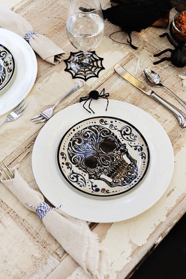 Halloween-themed-skull-plates-and-spiderweb-glasses
