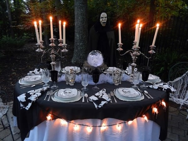Outdoor-Halloween-table-setting-with-large-candlesticks