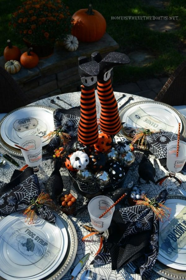 Outdoor-Halloween-table-setting-with-witchs-legs-centerpeice