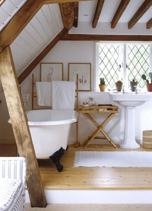 Rustic-attic-bathroom-with-wooden-beams