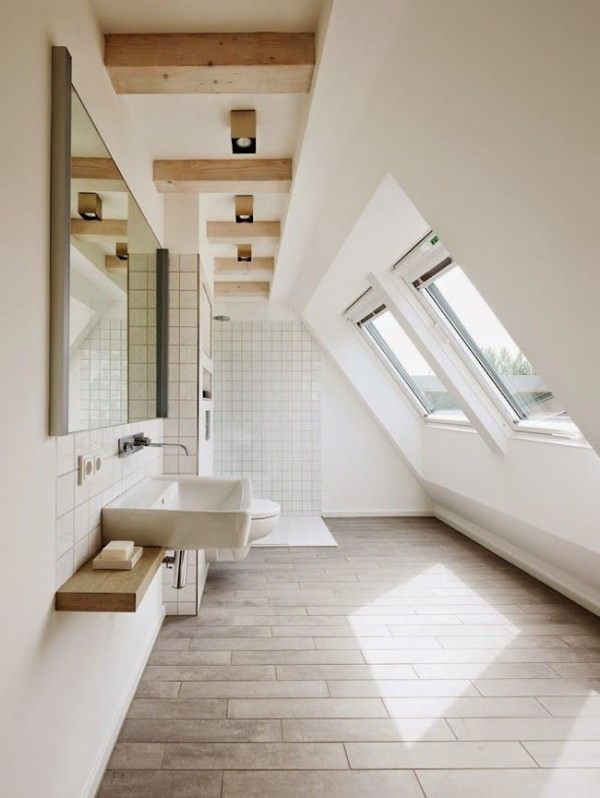Simple-bathroom-designed-to-highlight-attic-shape-and-architecture
