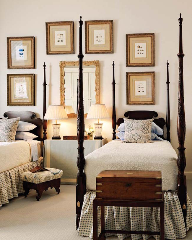Stunning-four-post-twin-beds-complimented-by-wall-art