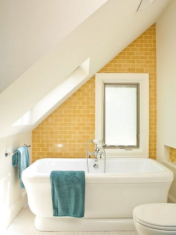 Tub-with-yellow-brick-wall-in-attic