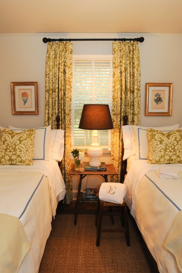 Twin-beds-in-small-guest-room-with-matching-curtains-and-pillows