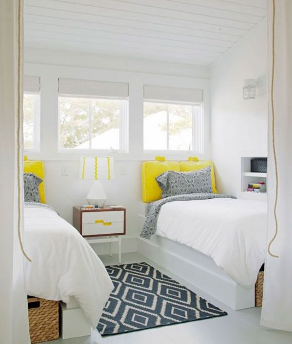 Very-white-guest-room-with-bright-yellow-twin-bed-pillows