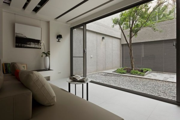Living-room-that-looks-out-into-bright-courtyard