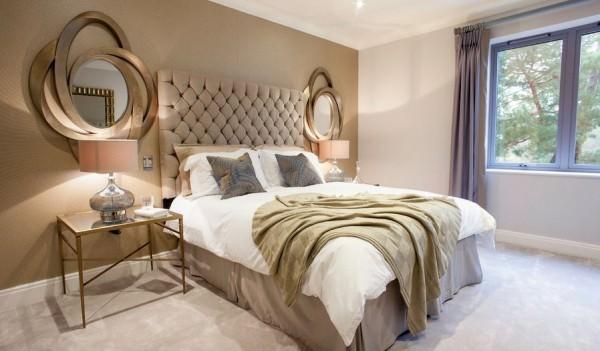 Luxury-golden-bedroom-with-tuftead-headboard