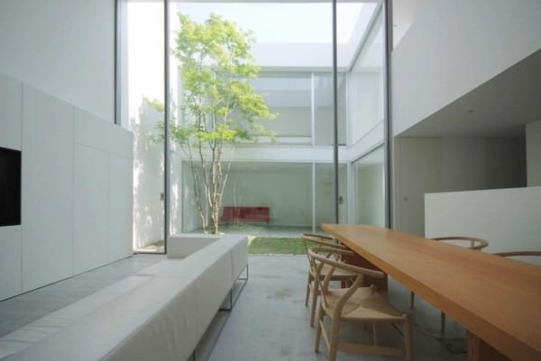Seating-areas-in-a-building-separated-by-a-small-courtyard