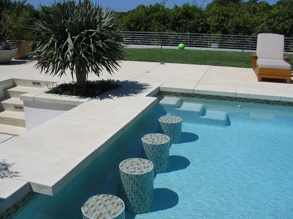 Acid-etch-finish-concrete-shapes-this-elegant-pool-deck-and-additional-features