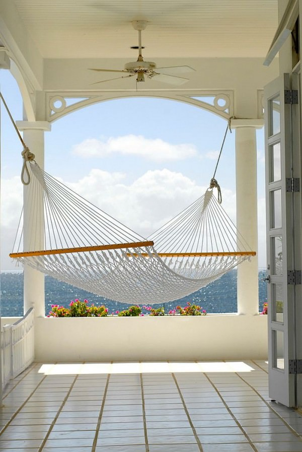 Beach-style-porch-with-hammock-overlooking-the-ocean