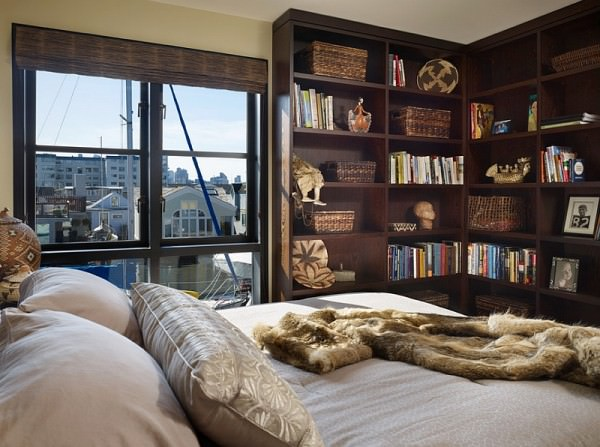 Beautiful-corner-bookshelf-in-the-bedroom-doubles-as-a-wonderful-display