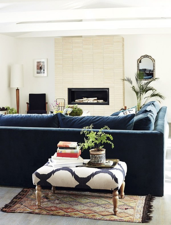 Deluxe-sofa-in-a-living-room-with-a-modern-fireplace