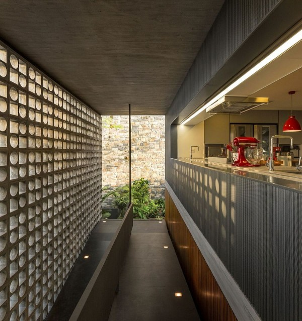 Hollowed-out-concrete-elements-allows-light-to-filter-through-into-the-kitchen