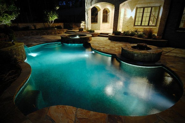 Ingenious-pool-with-twin-water-features-and-a-fire-pit