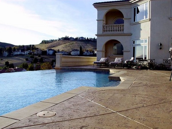 Mediterranean-style-pool-area-with-stamped-concrete-deck