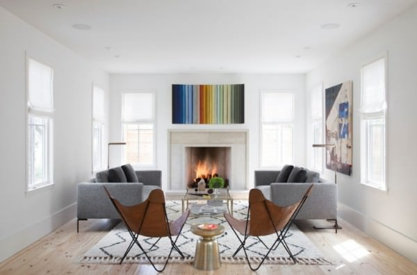 Modern-art-and-a-textured-rug-in-a-living-room-with-a-fireplace