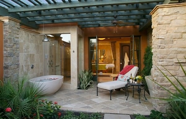 Outdoor-bathtub-and-shower-adjacent-to-the-bathroom-indoors