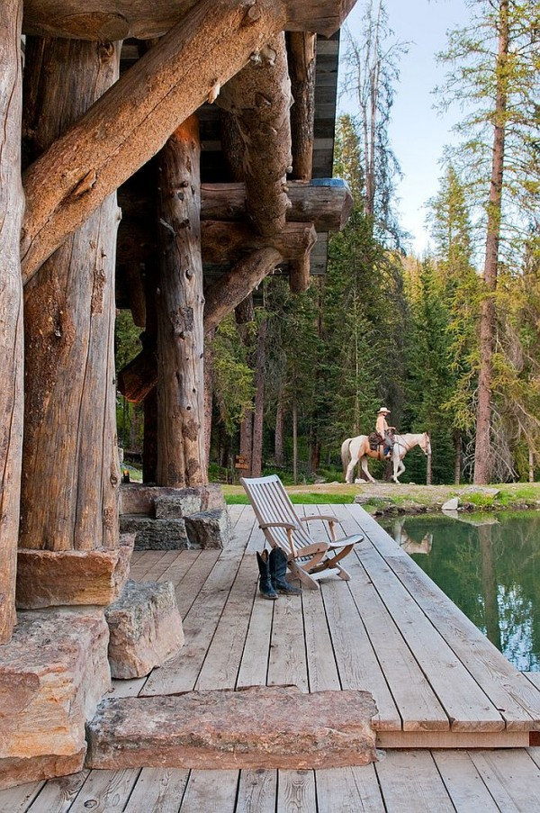 Relaxing-porch-of-the-Headwaters-camp-cabin-exudes-umatched-rustic-beauty