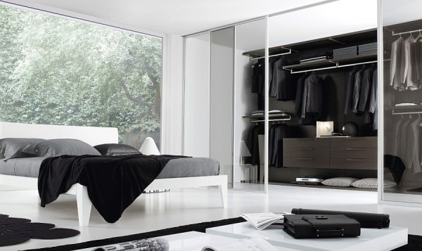Sleek-and-stylish-bedroom-in-black-and-white-with-a-walk-in-closet