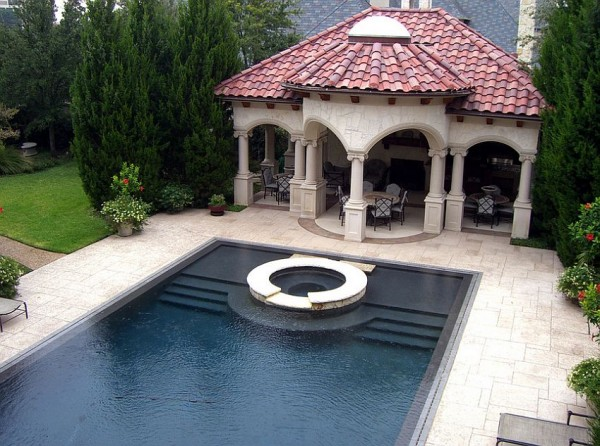 Stamped-concrete-pool-deck-is-both-aesthetic-and-durable