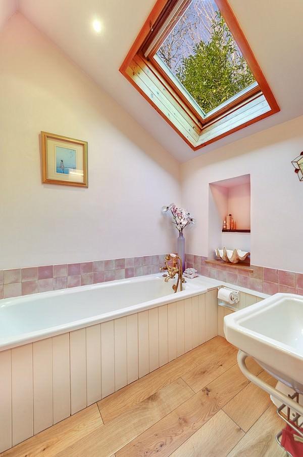 Tranquil-farmhouse-style-bathroom-with-a-skylight