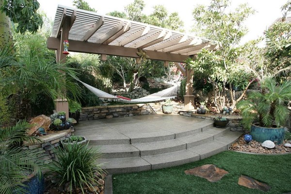 Tropical-style-landscape-with-pergola-and-hammock