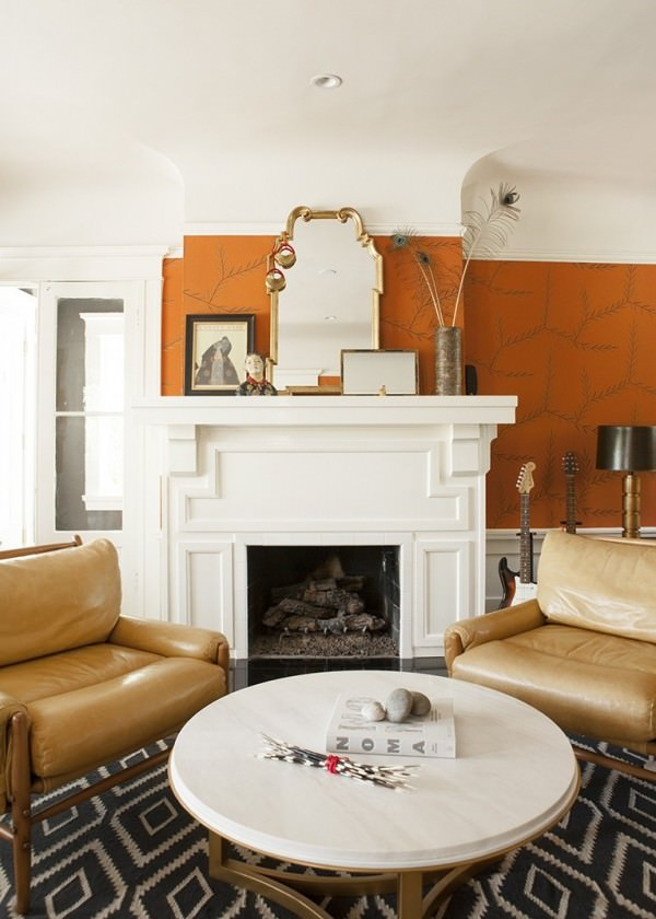 Warm-tones-and-interesting-details-in-a-room-with-a-fireplace