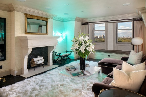 and-here-is-a-sitting-room-with-a-fireplace-blue-neon-lights-and-a-view-of-central-park