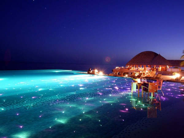 for-a-breathtaking-evening-swim-go-to-the-huvafen-sushi-resort-in-the-maldives-where-the-pool-is-covered-in-colored-lights-that-twinkle-beneath-the-surface