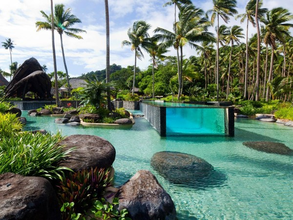 laucala-island-resort-in-fiji-has-an-epic-pool-within-a-pool-with-an-above-ground-glass-lap-pool-embedded-inside-the-larger-more-natural-looking-pool