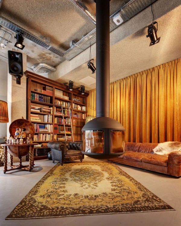 library-bookshelves-persian-rugs-hanging-fire-place