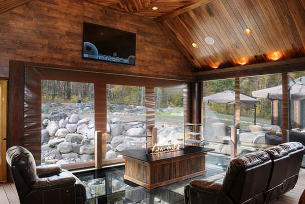 mountain-living-room-featuring-a-glass-floor-to-see-the-ground-or-river