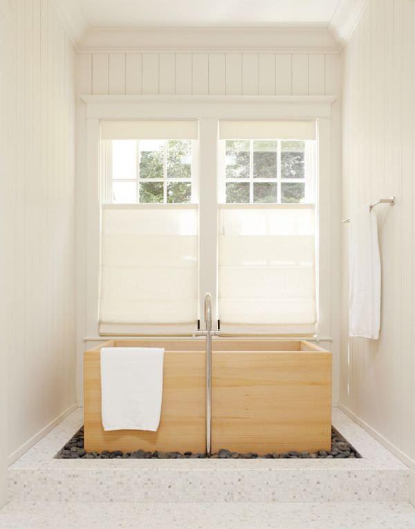 rocks-around-wooden-rectangular-bathtub