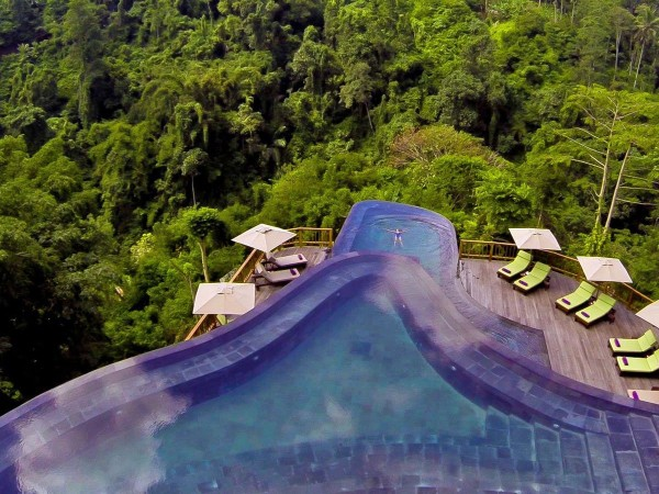 take-a-dip-in-one-of-the-multi-layered-infinity-pools-at-the-hanging-gardens-in-ubud-indonesia-while-being-surrounded-by-a-lush-and-tranquil-jungle