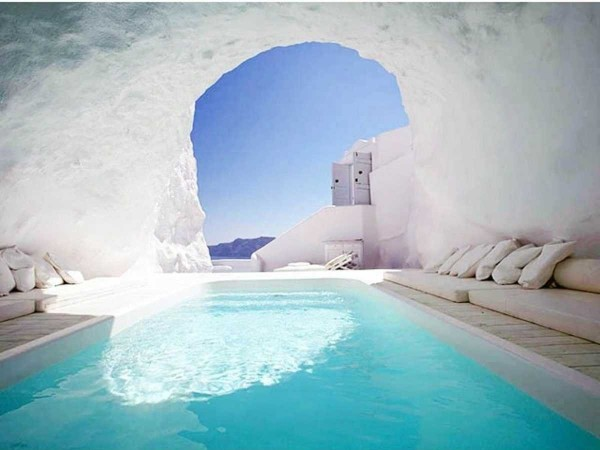 the-cave-pool-at-the-katikies-hotel-in-santorini-greece-offers-a-breathtaking-mediterranean-hideaway