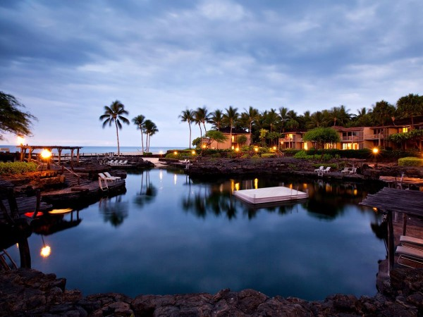 the-kings-pond-at-the-four-seasons-resort-hualalai-in-kailua-kona-hawaii-is-an-ocean-water-pool-carved-out-of-natural-lava-rocks-where-youll-find-18-million-gallons-of-water-manta-rays-and-over-3000-tropical-fish