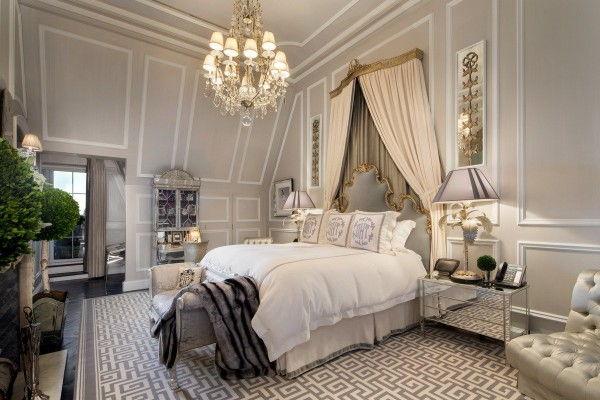 the-master-bedroom-has-a-more-neutral-palette-but-the-same-lavish-decor