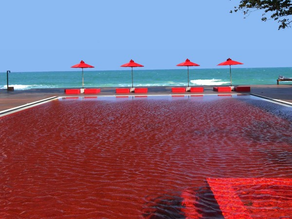the-pool-at-the-library-in-koh-samui-thailand-is-lined-with-blood-red-tiles-to-make-for-a-stunning-visual-effect